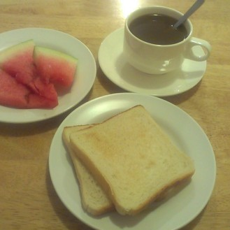 Typical breakfast: Borneo white coffee, toast and watermelon
